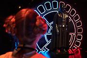 Een bezoekster verkleed als Star Wars figuur bekijkt het kostuum van Darth Vader. In Utrecht is de tentoonstelling Star Wars Identies te zien tot en met 11 maart 2018. Op de expositie zijn originele kostuums, rekwisieten en de personages te zien. Daarnaast kunnen bezoekers een eigen Star Wars identiteit maken door hun eigen karakter te combineren met fictieve elementen. Star Wars werd veertig jaar geleden, op 25 mei 1977, voor het eerst getoond op film. De filmserie is nog altijd mateloos populair.<br /> <br /> In Utrecht the exhibition Star Wars Identies is shown. The exhibition shows original costumes, props and the characters. In addition, visitors can create their own Star Wars identity by combining their own character with fictional elements. Star Wars was first shown on film forty years ago, on May 25, 1977. The film series is still very popular.
