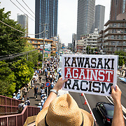 "KAWASAKI, JAPAN - JULY 16: Anti-racist holds a banner during a counter-protest rally against ""hate speech rally"" in Nakahara, Kawasaki City, Kanagawa prefecture, Japan on July 16, 2017. (Photo by Richard Atrero de Guzman/NUR Photo)"