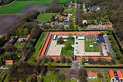 Nederland, Drenthe, Gemeente Noordenveld, 01-05-2013; gevangenisdorp Veenhuizen, gesticht in 1823 door de Maatschappij van Weldadigheid voor de heropvoeding van bedelaars en landlopers. Het Tweede Gesticht - met rood pannendak - is een van de oude dwanggestichten en huisvest nu het Gevangenismuseum.<br /> Veenhuizen prison village, founded in 1823 by the Benevolent Society for the rehabilitation of beggars and vagrants.<br /> The 'Second Establishment' - with red tile roof - is one of the old detention centers and now houses the Prison Museum.<br /> <br /> luchtfoto (toeslag op standard tarieven)<br /> aerial photo (additional fee required)<br /> copyright foto/photo Siebe Swart