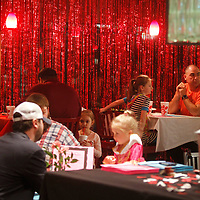 Area dads sit have dinner with their daughters at Chick-fil-a's Daddy Daughter Dinner Tuesday night in Tupelo.