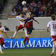 Tim Cahill, (left), New York Red Bulls, is challenged by Jeff Larentowicz, Chicago Fire, during the New York Red Bulls Vs Chicago Fire, Major League Soccer regular season match at Red Bull Arena, Harrison, New Jersey. USA. 10th May 2014. Photo Tim Clayton