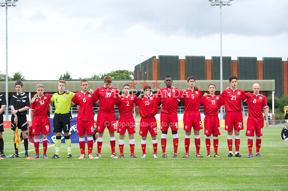 COLWYN BAY, WALES - Tuesday, August 28, 2012: Wales' players sing the national anthem before the International Friendly Under-16's match against Poland at Eirias Park. L-R: captain Joseff Morrell, goalkeeper Luke Pilling, Shane Parry, Will Abbotts, Clive Smith, Daniel James, Rollin Menayese, Ioan Evans, Harry Wilson, Cian Harries, Lloyd Humphries. (Pic by David Rawcliffe/Propaganda)