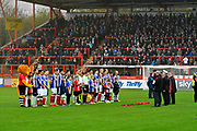Exeter City and Grimsby Town players and fans observe a minutes silence before the EFL Sky Bet League 2 match between Exeter City and Grimsby Town FC at St James' Park, Exeter, England on 11 November 2017. Photo by Graham Hunt.