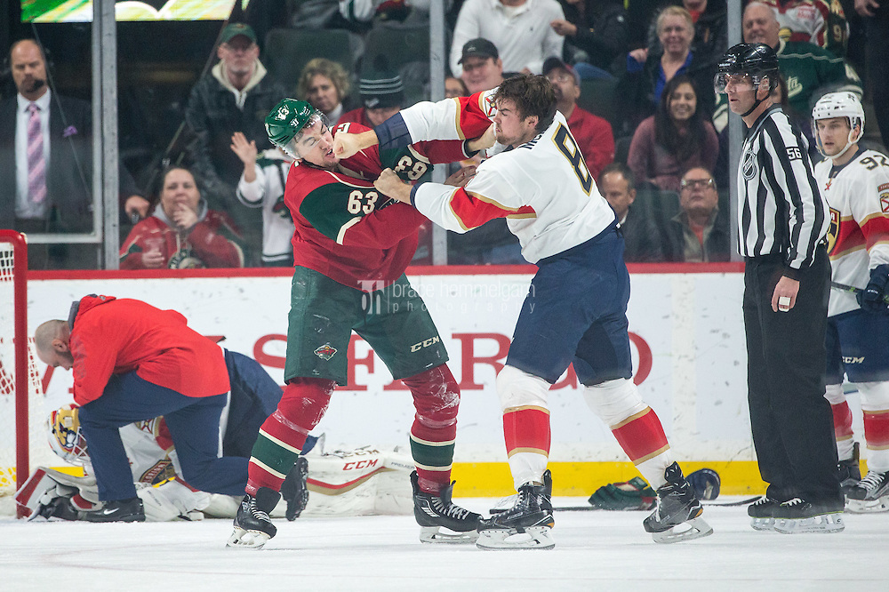 Dec 13, 2016; Saint Paul, MN, USA; Minnesota Wild forward Kurtis Gabriel (63) fights with Florida Panthers defenseman Dylan McIlrath (8) during the first period at Xcel Energy Center. Mandatory Credit: Brace Hemmelgarn-USA TODAY Sports