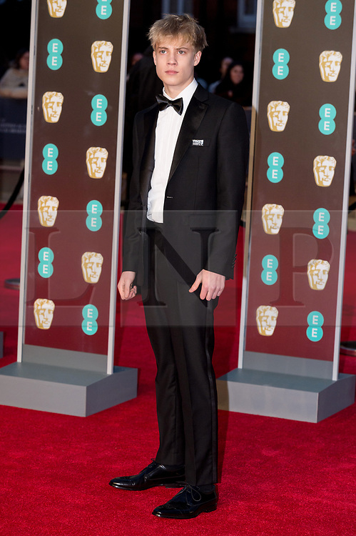 © Licensed to London News Pictures. 18/02/2018. TOM TAYLOR arrives on the red carpet for the EE British Academy Film Awards 2018, held at the Royal Albert Hall, London, UK. Photo credit: Ray Tang/LNP