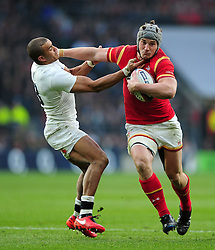 Jonathan Davies of Wales takes on the England defence - Mandatory byline: Patrick Khachfe/JMP - 07966 386802 - 12/03/2016 - RUGBY UNION - Twickenham Stadium - London, England - England v Wales - RBS Six Nations.