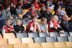 Young Bristol City fans look bored - Photo mandatory by-line: Dougie Allward/JMP - Tel: Mobile: 07966 386802 05/10/2013 - SPORT - FOOTBALL - Vale Park - Stoke-on-Trent - Port Vale V Bristol City - Sky Bet League 1