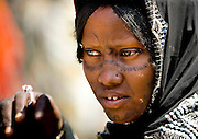 Are these the world's most painful tattoos? Ethiopian and Sudanese tribes show off their intricate raised patterns created using THORNS<br /> <br /> From delicate swirls of raised flesh to intricate dotted patterns, the scars that decorate the bodies of Ethiopia's Bodi, Mursi and Surma tribes are more than just the sign of an old injury.<br /> <br /> For these aren't just any scars: They're an elaborate part of local culture and signify everything from beauty to adulthood or even, in some cases, are simply a mark of belonging.<br /> <br /> But Ethiopian tribes aren't the only ones to embrace scarification. In Uganda, the Karamojong are famous for their elaborate scar patterns, while across Ethiopia's border with Sudan, Nuer men bear scarred foreheads and consider getting them a key part of the transition from boy to man. Now the stunning scar markings of Ethiopia and Sudan are the subject of an incredible set of photographs by French snapper, Eric Lafforgue, who travelled through the country observing cutting ceremonies and meeting the locals.<br /> <br /> During a visit to the Surma tribe, who live in the country's remote Omo Valley, he witnessed a scarification ceremony, which involved creating the patterns using thorns and a razor.<br /> <br /> 'The12-year-old girl who was being cut didn't say a word during the 10-minute ceremony and refused to show any pain,' he revealed. 'Her mother used a thorn to pull the skin out and a razor blade to cut the skin.<br /> <br /> 'At the end, I asked her whether having her skin cut had been tough and she replied that she was close to collapse. It was incredible as she didn't show any sign of pain on her face during the ceremony as that would have been seen as shameful for the family.'<br /> <br /> What's more, he explained, despite the pain, the girl herself initiated the ceremony as Surma girls aren't obliged to take part. 'Scars are a sign of beauty within the tribe,' he added.<br /> <br /> 'Children who go to school or convert to Christianity don't do it but the others see the ability to cope with pain as a sign that t