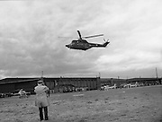 "Air Corps Takes Delivery Of Puma Helicoptor. (N86)..1981..22.07.1981..07.22.1981..22nd July 1981..The Air Corps took delivery,today, of a new French Built SA 330 J ""Puma"" Helicoptor. The ""Puma"" escorted by another Air Corps helicoptor landed at Casement Aerodrome, Baldonnell,Co Dublin...A cameraman snaps an image of the ""Puma' as it comes in to land at the aerodrome."