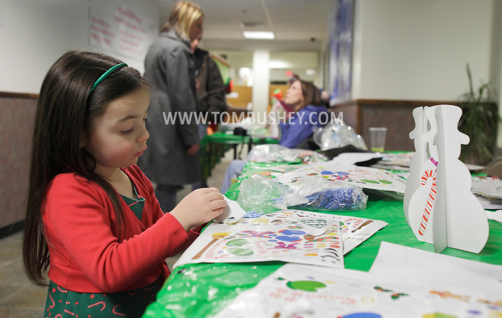 Middletown, New York - A young girl decorates with stickers during a holiday event at the Middletown YMCA on Dec. 4, 2010.