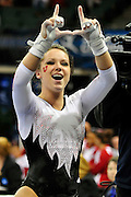 University of Utah junior Stephanie McAllister waves the Ute sign to the fans after her uneven parallel bars routine at the 2011 Women's NCAA Gymnastics Championship Team Finals on April 16, in Cleveland, OH. The Utes took fifth place overall. (photo/Jason Miller)