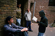 A young grime emcee recites his rhymes on a housing estate in Bow, East London. 2006.