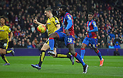 Emmanuel Adebayor goes for the lob during the Barclays Premier League match between Crystal Palace and Watford at Selhurst Park, London, England on 13 February 2016. Photo by Michael Hulf.
