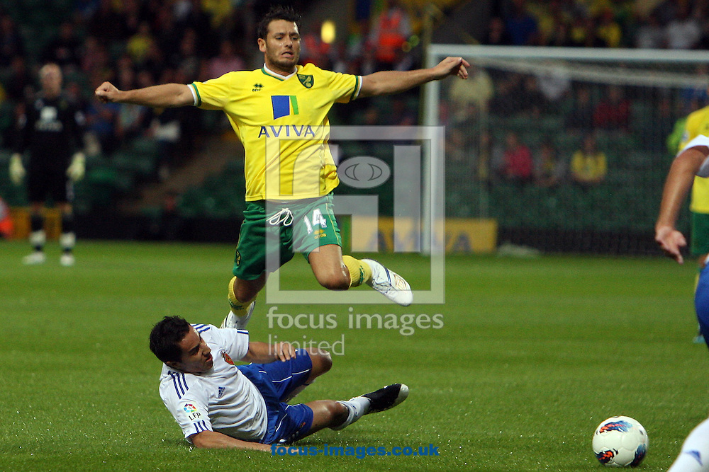 Wes Hoolahan of Norwich skips a heavy tackle from Efrain Juarez of Real Zaragoza during a pre season friendly at Carrow Road stadium, Norwich...Picture by Paul Chesterton/Focus Images Ltd.  07904 640267.3/8/11
