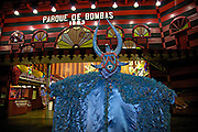 A costumed vejigantes poses in front of the historic Parque de Bombas a former fire house and now a museum February 19, 2009 in Ponce, Puerto Rico.
