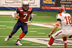 14 March 2009:Mitch Tanney looks for the lane up field on a quarterback keeper play. The Sioux Falls Storm were hosted by the Bloomington Extreme in the US Cellular Coliseum in downtown Bloomington Illinois.