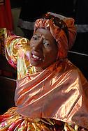 Madamas durante misa en el Carnaval de El Callao en Venezuela. Las Madamas, con coloridas faldas largas y pañuelos en la cabeza, evocan a las matronas de las islas antillanas, siendo un símbolo de la importancia femenina en esta festividad. El Carnaval, celebrado entre los meses de febrero y marzo, tiene en El Callao una de sus manifestaciones más alegres y coloridas, gracias a la riqueza cultural de su mestizaje. El Callao, 2007 (Ramon Lepage / Orinoquiaphoto)  Madamas of the El Callao Carnival in Venezuela. The Madamas wear colorful long skirts and head turban like the old ladies of Antillean islands, being a symbol of the importance of the feminine. Carnival, celebrated between February and March, have in El Callao one of its colorful and happiest expressions, thanks to their cultural mestization. El Callao, 2007 (Ramon Lepage / Orinoquiaphoto).