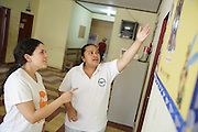 Sabin Institute senior program officer Karen Palacio, (left) listens to a health worker tell her about deworming activities at the health center in San Esteban, Honduras on Thursday April 25, 2013.
