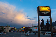 "Restaurant sign at Cowboy's Lodge and Grille, Gardiner, Montana, the north west gateway town to Yellowstone National Park, with a rainstorm commencing in the background. This mage can be licensed via Millennium Images. Contact me for more details, or email mail@milim.com For prints, contact me, or click ""add to cart"" to some standard print options."