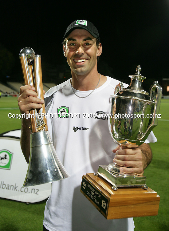 New Zealand captain Stephen Fleming holds the Chappell Hadlee trophy and the National Bank trophy as New Zealand won the match by 1 wicket chasing Australia's 346 during the 3rd Chappell Hadlee one day match at Seddon Park, Hamilton, New Zealand on Tuesday 20 February 2007. New Zealand won the series 3-0. Photo: Andrew Cornaga/PHOTOSPORT<br />