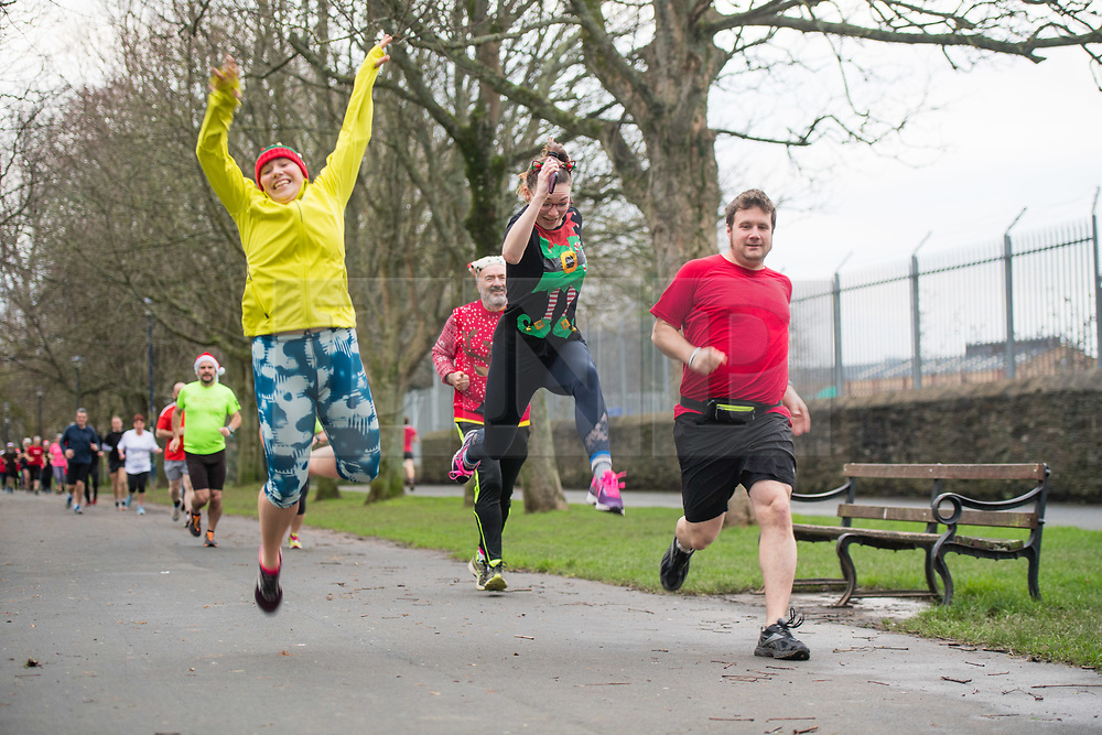 © Licensed to London News Pictures<br /> Aberystwyth Wales UK, Christmas Day, 25/12/2018<br /> Christmas Day 2018: Over 100 people, many wearing Xmas themed clothes, took part in the 5km 'park run' in Aberystwyth Wales on a mild and grey Christmas Day , December 25 2018<br /> photo credit Keith Morris / LNP © Licensed to London News Pictures. 25/12/2018. Aberystwyth, UK. Over 100 people, many wearing Xmas themed clothes, took part in the 5km 'park run' in Aberystwyth Wales on a mild and grey Christmas Day , December 25 2018<br />