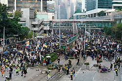Hong Kong. 1 October 2019. After a peaceful march through Hong Kong Island by an estimated 100,000 pro democracy supporters, violent flared up at Tamar, Admiralty and moved through Wanchai district. Police used teargas and baton rounds and water cannon. Hard core group lit fires, threw bricks and Molotov cocktails at police. Violence continues into evening. Protestors on streets at Admiralty await attack by riot police. Iain Masterton/Alamy Live News.