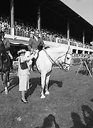 The Dublin Horse Show.1982.07.08.1982.08.07.1982.7th August 1982...The Dublin Horse Show..R.D.S., Ballsbridge, Dublin.The winners of the Aga Khan team trophy were Great Britain. The shows' leading rider was Mr Harvey Smith, Great Britain. .Image,Mr David Broome accepts his team award from Mrs Hely Hutchinson.
