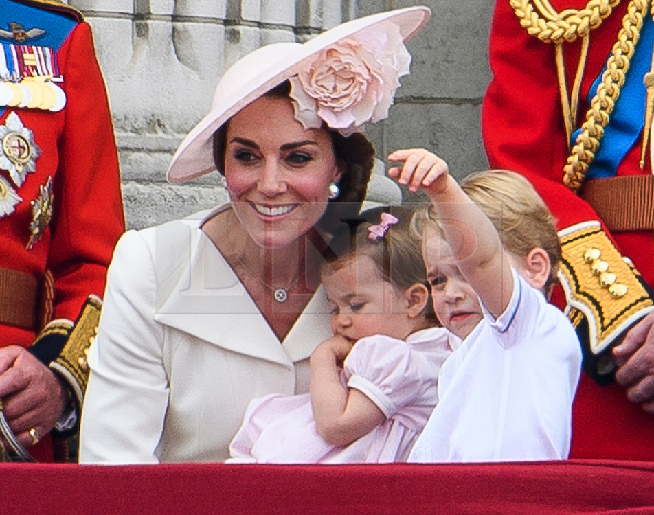 © Licensed to London News Pictures. 11/06/2016. London, UK. CATHERINE, DUCHESS OF CAMBRIDGE, PRINCESS CHARLOTTE and PRINCE GEORGE  on the balcony of Buckingham Palace, during the Trooping The Colour ceremony in London. This years event is part of a weekend of celebration to mark the 90th birthday of Queen Elizabeth II, who is Britain's longest reigning monarch. Photo credit: Ben Cawthra/LNP
