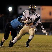 North Brunswick High School's Shack Graham rushes against South Brunswick High School's A. J. Price Friday September 13, 2013. (Jason A. Frizzelle)