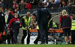 Swansea City's Kyle Bartley is stretchered off during the Carabao Cup, Second Round match at Stadium MK, Milton Keynes.