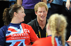 Prince Harry talks with participants from the Great Britain wheelchair rugby team - Photo mandatory by-line: Dougie Allward/JMP - Mobile: 07966 386802 - 12/09/2014 - The Invictus Games - Day 2 - Wheelchair Rugby - London - Copper Box Arena
