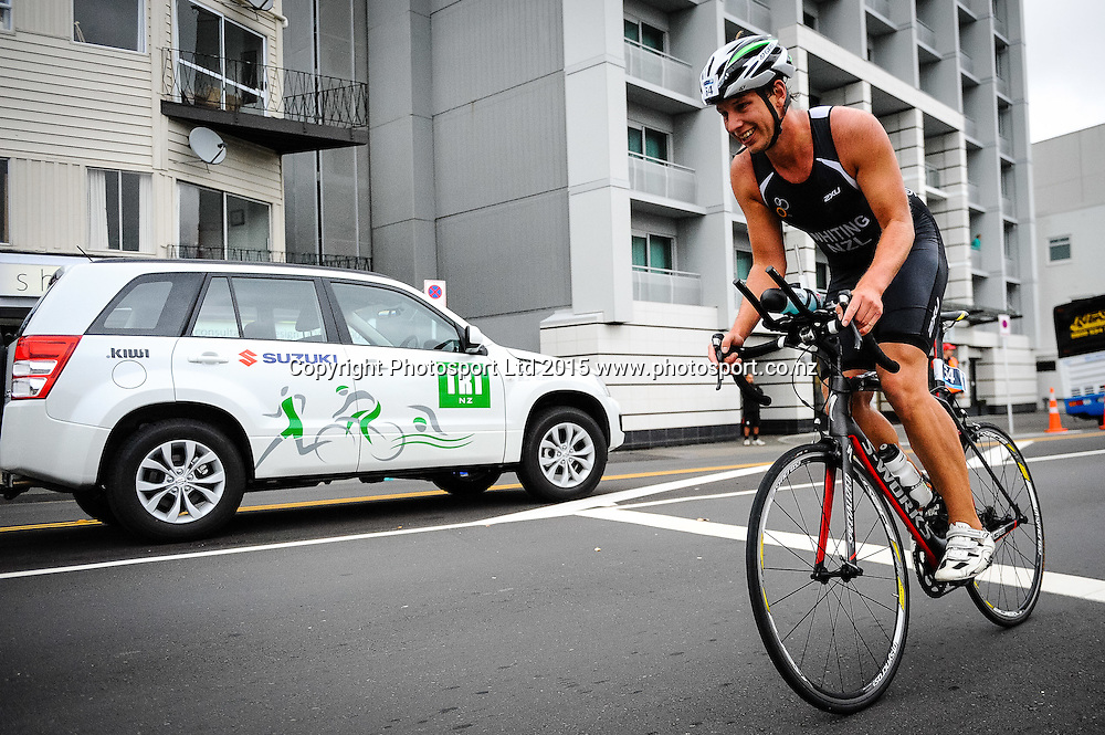A competitor rounds a turn on the bike leg of the Sovereign Tri Series, Waterfront, Wellington, New Zealand. Saturday 14 March 2015. Copyright Photo: Mark Tantrum/www.Photosport.co.nz