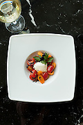 Caprese: burrata, tomato, purple basil, flaked salt, olive oil, and aged balsamic vinegar