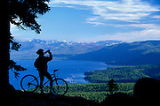 A mountain biker enjoys a view of Lake Tahoe from the Tahoe Rim Trail near Watson lake on the North Shore.