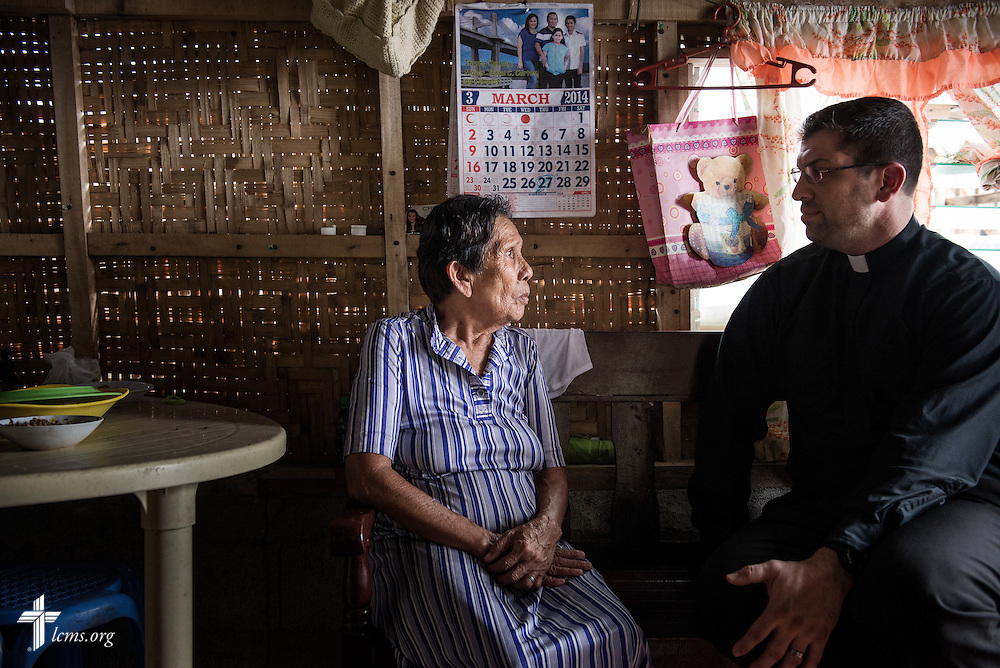 The Rev. Ross Johnson, director of LCMS Disaster Response, talks with Perpetua in Balugo, Leyte Province, Philippines, on Saturday, March 15, 2014. LCMS disaster dollars from donors helped rebuild her home following damage from Typhoon Haiyan. LCMS Communications/Erik M. Lunsford