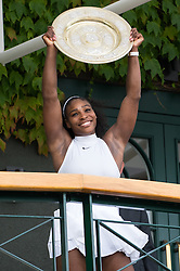 LONDON, ENGLAND - Saturday, July 9, 2016: Serena Williams (USA) celebrates as she holds the Venus Rosewater Dish on the balcony of the Players' Clubhouse after winning the Wimbledon Ladies' Singles Final 7-5, 6-3, her 22nd Grand Slam singles title, on day thirteen of the Wimbledon Lawn Tennis Championships at the All England Lawn Tennis and Croquet Club. (Pic by Kirsten Holst/Propaganda)
