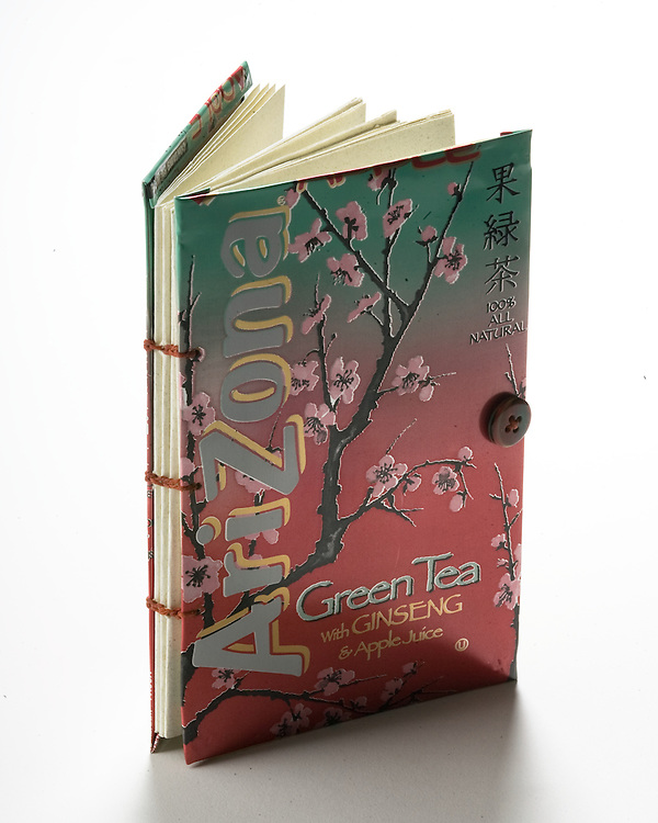 Artist: Shanna Kaczynski. A coptic syle binding using a recycled beverage can for front and back covers.