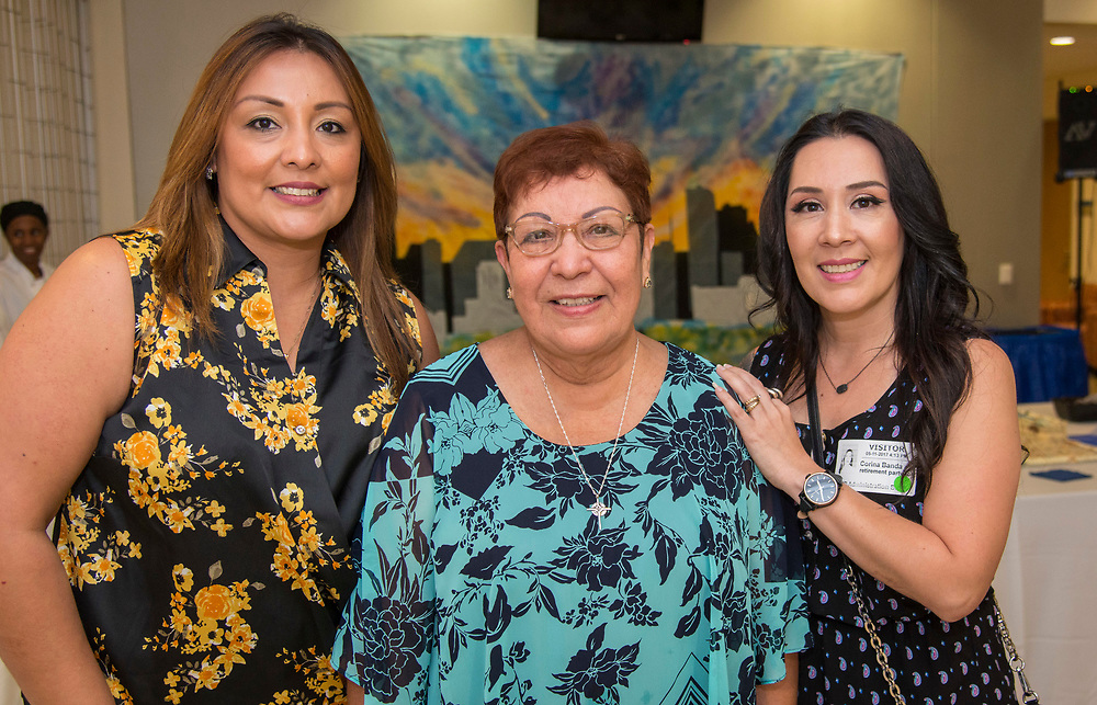 Maria Espinoza is flanked by her daughters during a Retiree Reception at Hattie Mae White, May 11, 2017.