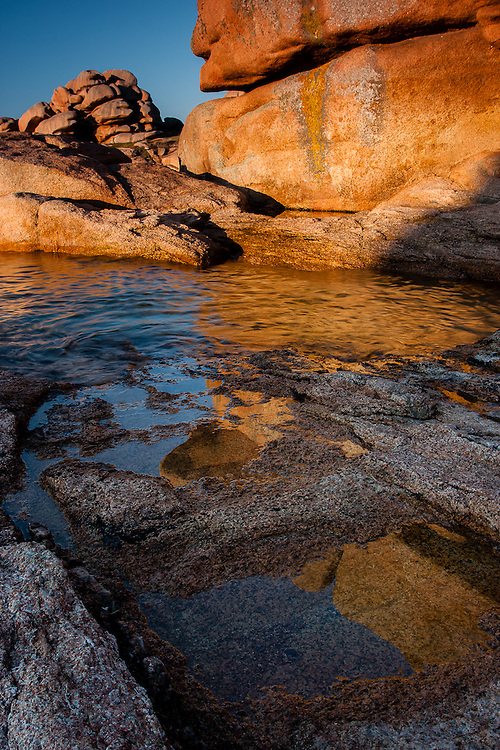 At Ploumanach the huge granit boulders by the seaside are lit with warm afternoon light