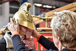 © Licensed to London News Pictures. 09/09/2017. London, UK. A visitor tries on a helmet from a Dennis N-Type 1916 fire engine at London Fire Brigade's annual Fire Engine Festival in Lambeth. The earliest motorised fire engines still working, London Fire Brigade's brand new pump as well firefighter uniforms are on display. Photo credit : Stephen Chung/LNP