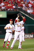 29 June 2010: St. Louis Cardinals shortstop Felipe Lopez (3) catches a fly ball hit by a Diamondback batter during Tuesday's game against Arizona  at Busch Stadium in St. Louis, Missouri.