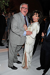 CHRISTOPHER BIGGINS and JOAN COLLINS at a dinner hosted by Cartier following the following the opening of the Chelsea Flower Show 2012 held at Battersea Power Station, London on 21st May 2012.