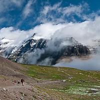 hikers on the hidden lake trail, glacier national park, montana, usa, crown of the continent