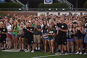 Students learn the Ohio University fight song in Peden Stadium on Saturday, August 20, 2016. © Ohio University / Photo by Kaitlin Owens