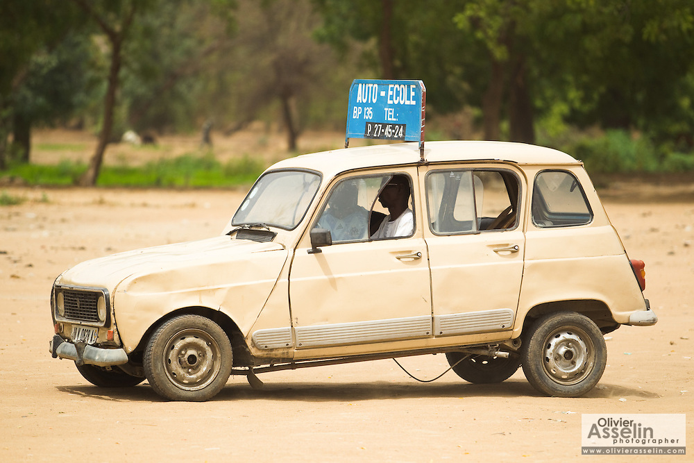A man takes driving lessons in an open field in N'Djamena, Chad on Tuesday June 8, 2010.