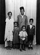 Nubian children pose for a family photo.  (1956)
