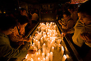 The annual Lotus Lantern Festival is held to celebrate Buddha's Birthday. Lighting candles at Jogyesa temple.