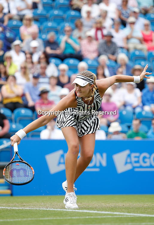 23.06.2016 Eastbourne, England. Aegon International Eastbourne Tennis Tournament  Kristina Mladenovic (FRA) returns as she is defeated by a score of  7-6(6), 4-6, 6-3 by Monica Puig (PUR in their Quarterfinals match at Devonshire Park.