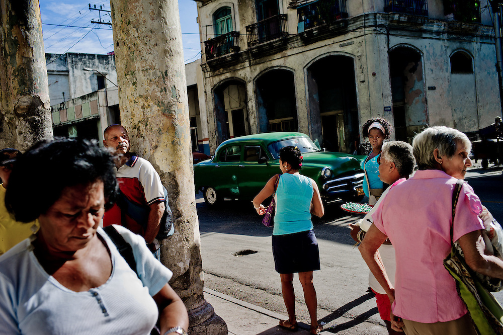 Street scene in Havana, Cuba. <br /> With Cuba cautiously introducing free-market changes that have legalized hundreds of thousands of small private businesses over the past two years, new economic bonds between Cuba and the United States have formed, creating new challenges, new possibilities &mdash; and a more complicated debate over Washington&rsquo;s 50-year-old trade embargo. The longstanding logic has been that broad sanctions are necessary to suffocate the totalitarian government of Fidel and Ra&uacute;l Castro. Now, especially for many Cubans who had previously stayed on the sidelines in the battle over Cuba policy, a new argument against the embargo is gaining currency &mdash; that the tentative move toward capitalism by the Cuban government could be sped up with more assistance from Americans.Photo/Tomas Munita for The New York Times