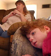 Ciara Bennett rests on the couch at home with her mom, Alicia, nearby. February  23, 2004